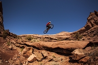 A man getting air on a jump on his montain bike near Moab, Utah.