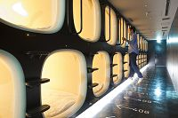 Japan, Honshu Island, Kinki region, Kyoto, Capsule Hotel, Nine hours, capsule beds  Keyword:   Adult, Architecture, Asia, Bed, Building, Design, Eastern Asia, furniture, Honshu, Horizontal, hotel business, Indoors, Japan, Kinki, Kyoto, luxury hotel, Man, People, Tourism, tourist