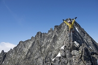 Woman climbing on the North Ridge of Forbidden Peak in North Cascades National Park.