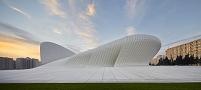 建築名: ヘイダル・アリエフ文化センター  設計: ザハ・ハディド  建設: 2013年  カテゴリ: コンサートホール 総合文化施設   所在地: アゼルバイジャン    Building Name: HEYDAR ALIYEV CULTURAL CENTER  Building Type: PUBLIC AND GOVERNMENT - CULTURAL INSTITUTION  Architect: ZAHA HADID ARCHITECS  Architect Website: http://www.zaha-hadid.com  Street:   Clients Website:   Town: BAKU  Year of Completion: 2013  County: BAKU  Collection Architecture  Country: Azerbaijan   The Heydar Aliyev Center principally consists of two collaborating systems: a concrete structure combined with a space frame system. In order to achieve large-scale column-free spaces that allow the visitor to experience the fluidity of the interior, vertical structural elements are absorbed by the envelope and curtain wall system. Its design establishes a continuous, fluid relationship between its surrounding plaza and the building's interior. The plaza, as the ground surface; accessible to all as part of Baku's urban fabric, rises to envelop an equally public interior space and define a sequence of event spaces dedicated to the collective celebration of contemporary and traditional Azeri culture.