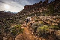 A man mountain biking on the Hymasa trail, Moab, Utah. Photo by Whit Richardson
