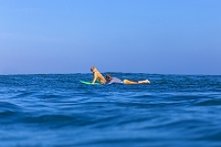 Surfer with a dog on the surfboard. Photo by Konstantin Trubavin / Aurora Photos
