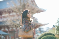 Mature female tourist visiting Senso-Ji Temple, Asakusa, Tokyo, Japan