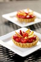Raspberry tart on white plate, close-up