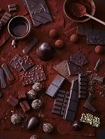 Various types of chocolates and pralines on cocoa powder