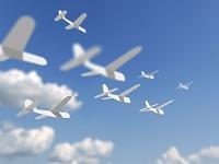 飛ぶカラフルな紙飛行機