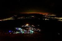 山梨県 富士山九合目を登る夜間登山者の行列と下界の夜景