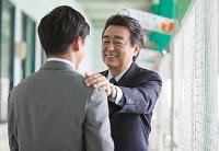 バッティングセンターで話す日本人ビジネスマン