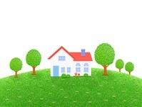 芝生の丘の一軒家と樹木