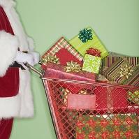 クリスマスプレゼントを運ぶサンタクロース