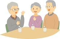 老人ホームで会話を楽しむシニア