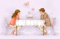 金魚と若いカップル