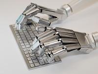 キーボードをうつロボット