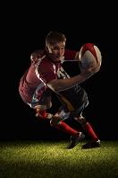 攻防するラグビー選手たち