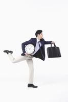 走るビジネスマン 時計