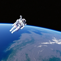 地球と宇宙遊泳する飛行士のイメージ