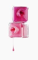 ボトルから垂れるピンクのマニキュア液