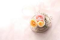 三輪のバラの花とティーカップ