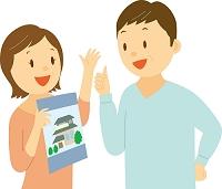 家の購入を検討する中年夫婦