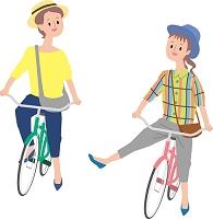 自転車にのる若い女性