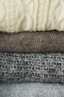 積み重なるセーター