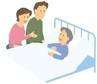 入院している老人女性とお見舞いに来た家族