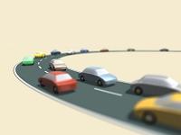 道を走るおもちゃの自動車