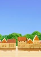 木の家の街と青空