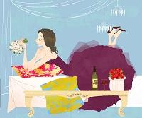 ベッドに横たわるドレスの女性