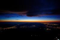 山梨県 富士山頂からの夜明けと下界の夜景