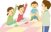学童保育で指導員に遊んでもらう小学生