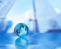 イメージ ビル群の写るガラスの地球儀