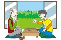 囲碁をするシニア男性と男の子