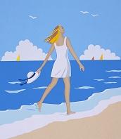 砂浜を散歩する女性