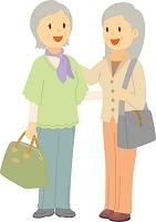 友人と旅行に出かける日本人のシニア女性