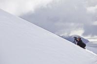 アルゼンチン 雪山を撮影するカメラマン