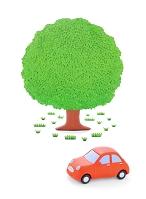 赤い粘土の車と大樹
