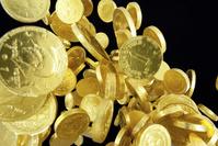 飛び上がる金貨