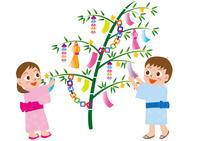 七夕の笹飾りと子供