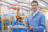 工場で働く作業員働く人々