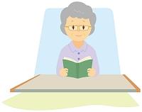 介護ベッドで本を読む老人女性