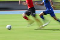 サッカーの競り合い