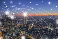 東京の高層ビル群と光のネットワーク 合成