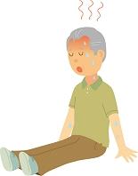 脱水症状で座り込むシニア男性