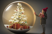 クリスマスプレゼントを抱えた子供