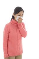 マスクをした体調不良の女性