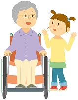 車椅子に乗る祖母に話しかける孫