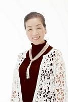 笑顔のシニア日本人女性(合成)