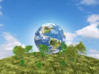 青空バックの草原の丘に樹木と地球
