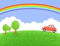 丘を走る赤い車と虹